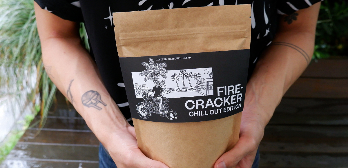 A bag of Single O's Firecracker Blend being held by barista