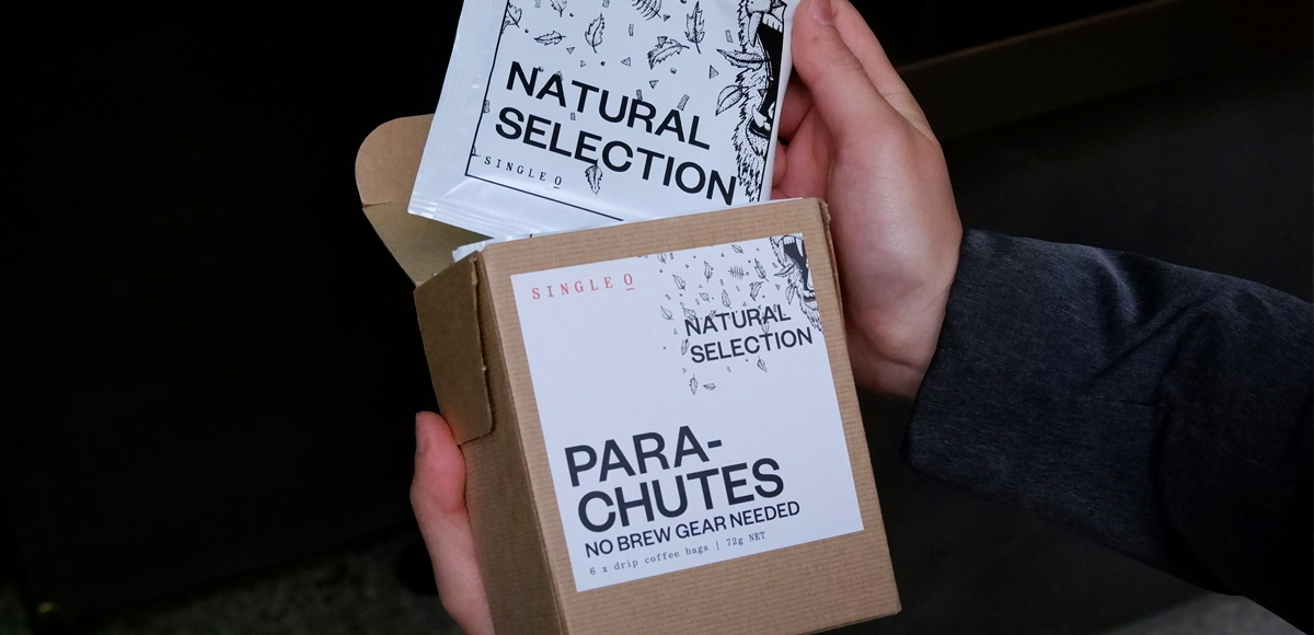 A Box of Single O Natural Selection Parachutes - Drip Coffee Bags being opened